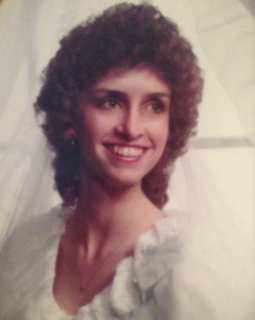 "It was the 1980's! Yes, I had the permed hair and the ""Lady Di"" wedding dress, giant sleeves and all!"