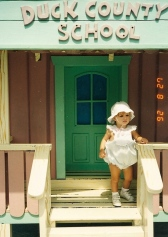 One year old girl in front of small house at Walt Disney World