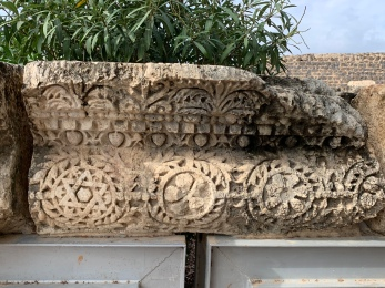 Decorative stone with carvings of pomegranates, flowers and star of David