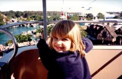 Girl in gondola ride over Fantasyland Walt Disney World