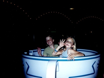 Two girls in Mad Hatter's Tea Cup ride at Walt Disney World