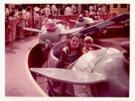 Girl and boy on Dumbo flying elephant ride at Walt Disney World