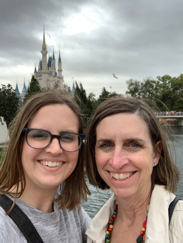 Mother and adult daughter in front of Cinderella's Castle