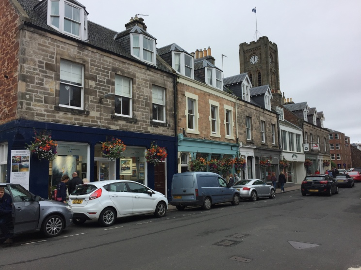 Row of 18th century stone houses and storefronts in Scotland