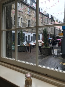 View of a pedestrian street from inside a coffee shop