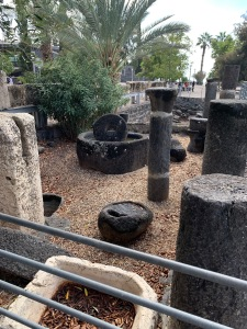 Olive press made of black stone along with some columns