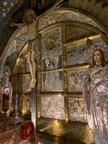 Ornate silver and gold crucifix and altar screen at the Church of the Holy Sepulchre