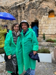 Couple standing in front of opening to empty tomb