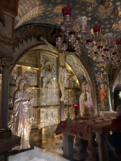 Altar with silver icons of Jesus and Mary