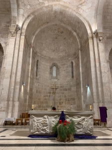 Altar area of church with high vaulted ceiling