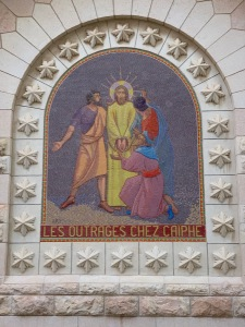 colorful mosaic of Jesus with his hands bound, surrounded by three men