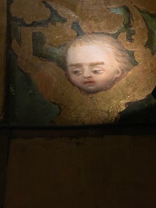 Painting of an angel face looking down