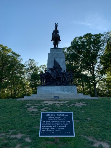 Monument which includes a statue of a man on a horse and 7 statues at the base depicting the different types of men who joined the Confederate army