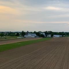 Farm with white barn