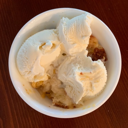 Bowl of Peach Cobbler and Ice Cream