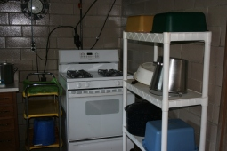Stove and Shelves of Pots and Pans